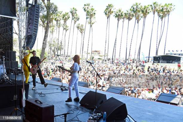 Brooke Dickson Lydia Night and Genessa Gariano of The Regrettes perform onstage at KROQ Weenie Roast Luau at Doheny State Beach on June 08 2019 in...