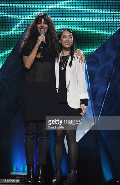 Brooke Fraser accepts her award with Alisa Xayalith of The Naked and Famous during the 2011 Vodafone Music Awards at Vector Arena on November 3 2011...