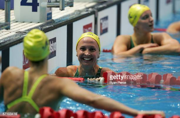 Brooke Hanson of Australia congratulates her teammate Stephanie Rice of Australia on her winning gold in the women's 200m individual medley during...