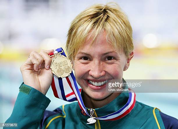Brooke Hanson of Australia poses for photographers with her gold medal after winning the Women's 100m individual medley during day three of the FINA...