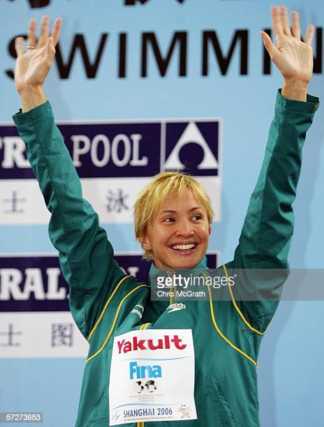 Brooke Hanson of Australia waves to the crowd after winning gold in the Women's 100m individual medley during day three of the FINA World Swimming...