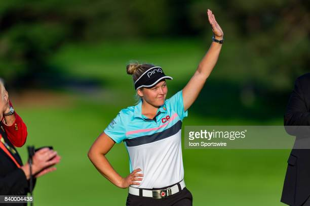 Brooke Henderson acknowledges the cheering crowd during the award ceremony after the final round of the Canadian Pacific Women's Open on August 27...