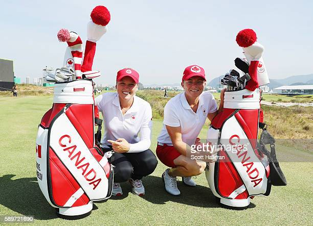 Brooke Henderson and Alena Sharp of Canada pose together during a practice round prior to the start of the women's golf during Day 10 of the Rio 2016...
