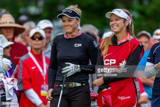 Brooke Henderson and her sister/caddie Brittany share a moment before teeing off on the first hole during the first round of the Canadian Pacific...