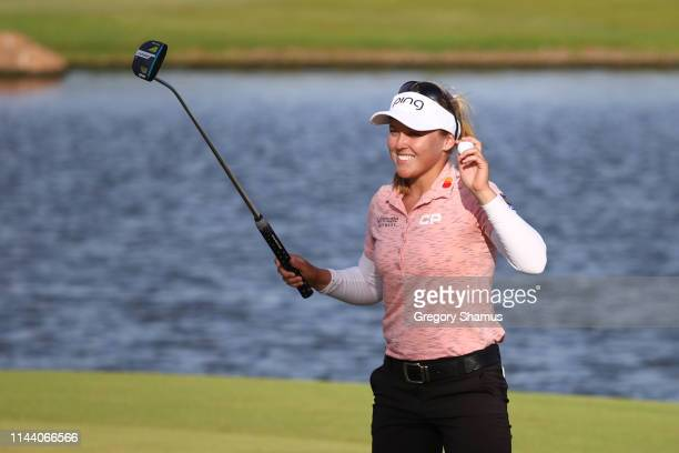 Brooke Henderson celebrates winning the LOTTE Championship on the 18th green at Ko Olina Golf Club on April 21 2019 in Kapolei Hawaii