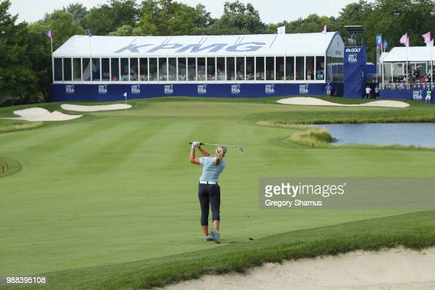 Brooke Henderson hits her second shot on the 18th hole during the final round of the 2018 KPMG PGA Championship at Kemper Lakes Golf Club on June 30...