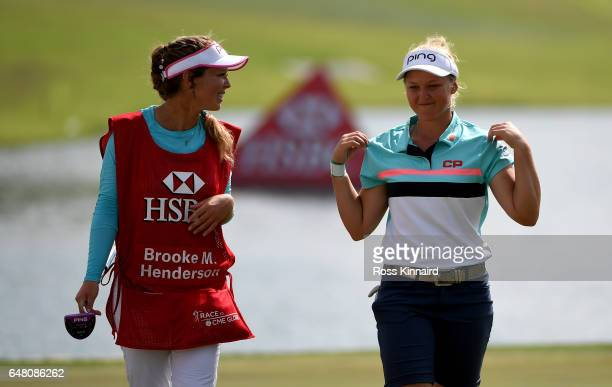 Brooke Henderson of Canada and her caddie Brittany Henderson on the par five 5th hole during the final round of the HSBC Women's Champions on the...