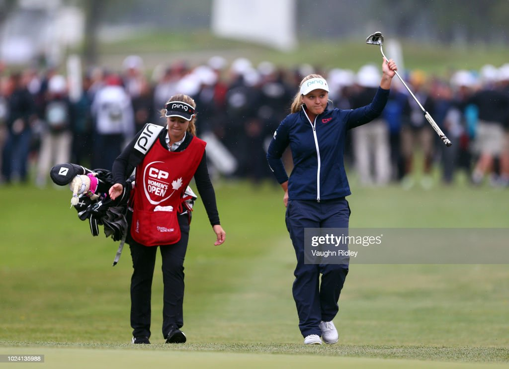 Brooke Henderson of Canada and her sister & caddie Brittany (L), walk up the 18th fairway to applause from the crowd during the final round of the CP Womens Open at the Wascana Country Club on August 26, 2018 in Regina, Canada.
