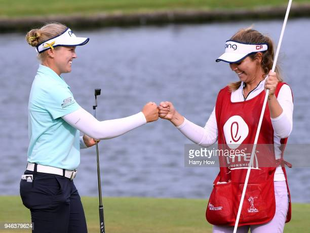 Brooke Henderson of Canada celebrates a four shot victory with her her caddie and sister Brittany Henderson to win the LPGA LOTTE Championship at the...