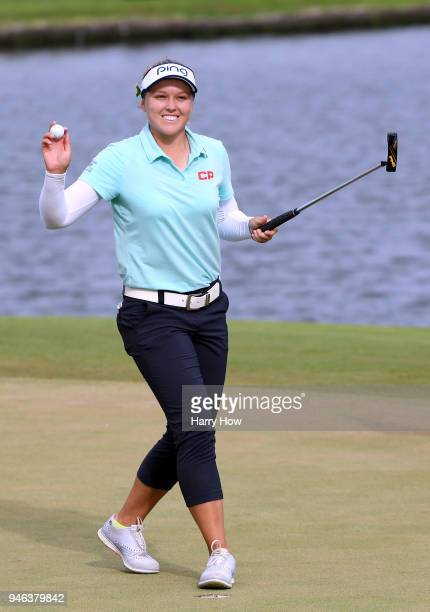Brooke Henderson of Canada celebrates her final putt and a four shot victory on the 18th green to win the LPGA LOTTE Championship at the Ko Olina...