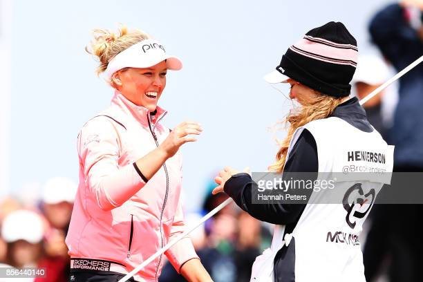 Brooke Henderson of Canada celebrates with her sister Brittany Henderson after winning the New Zealand Women's Open at Windross Farm on October 2...