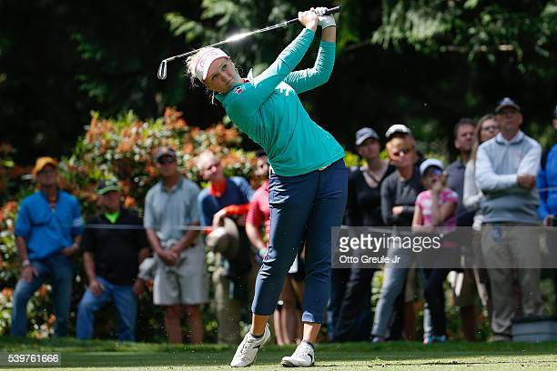 Brooke Henderson of Canada hits a tee shot on the 13th hole during the final round of the KPMG Women's PGA Championship at Sahalee Country Club on...