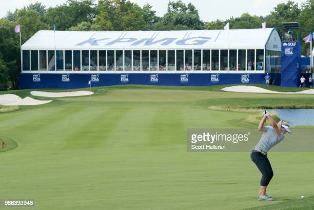 Brooke Henderson of Canada hits her second shot on the 18th hole during the third round of the KPMG Women's PGA Championship at Kemper Lakes Golf...