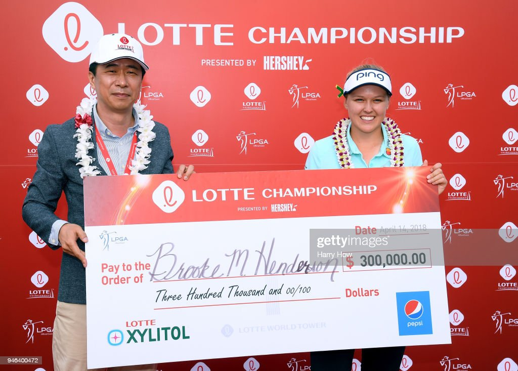 Brooke Henderson of Canada is presented the winner's check by Kap Lee, CEO of Dahong Communications, after her four shot victory during the fourth round of the LPGA LOTTE Championship at the Ko Olina Golf Club on April 14, 2018 in Kapolei, Hawaii.