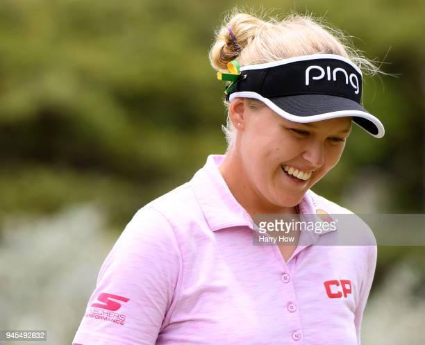 Brooke Henderson of Canada laughs after finishing her round as the leader during the second round of the LPGA LOTTE Championship at the Ko Olina Golf...