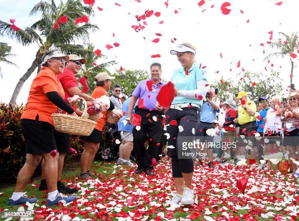 Brooke Henderson of Canada laughs as flower petals fall at a victory ceremony after her four shot win in the LPGA LOTTE Championship at the Ko Olina...