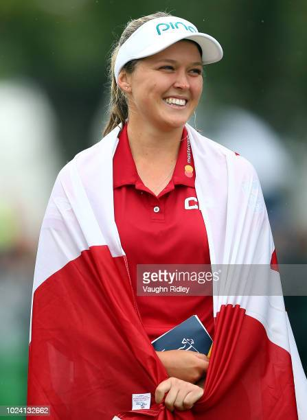 Brooke Henderson of Canada laughs during the winners ceremony following the final round of the CP Womens Open at the Wascana Country Club on August...