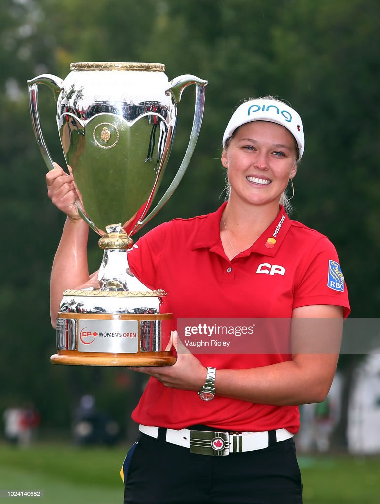 Brooke Henderson of Canada lifts the champions trophy following the final round of the CP Womens Open at the Wascana Country Club on August 26, 2018 in Regina, Canada.