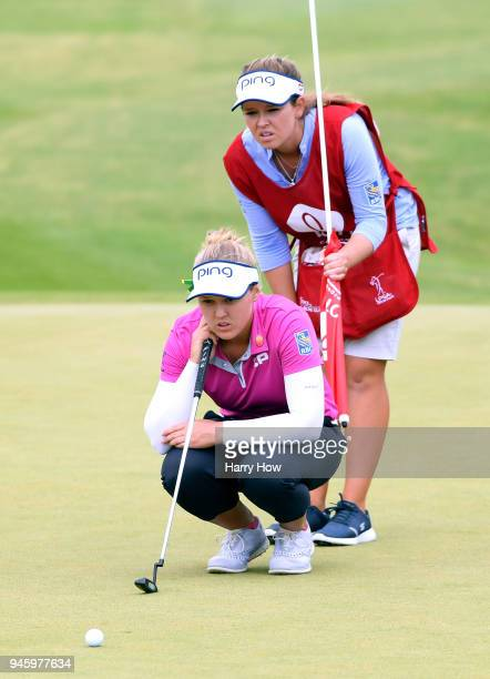 Brooke Henderson of Canada lines up her putt on the 5th green with her caddie Brittany Henderson during the third round of the LPGA LOTTE...