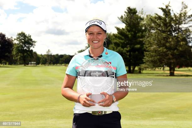 Brooke Henderson of Canada poses with the championship trophy during the final round of the Meijer LPGA Classic at Blythefield Country Club on June...
