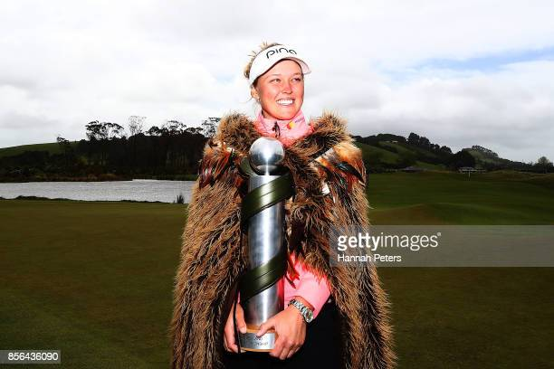 Brooke Henderson of Canada poses with the New Zealand Women's Open trophy by MC Kim during day five of the New Zealand Women's Open at Windross Farm...