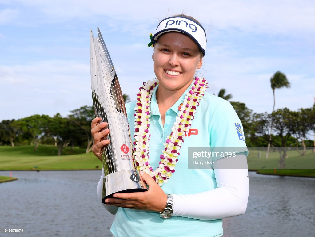 Brooke Henderson of Canada poses with the trophy after a four shot victory in the LPGA LOTTE Championship at the Ko Olina Golf Club on April 14, 2018 in Kapolei, Hawaii.
