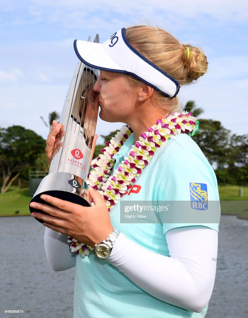 Brooke Henderson of Canada poses with the trophy after a four shot victory after the fourth round of the LPGA LOTTE Championship at the Ko Olina Golf Club on April 14, 2018 in Kapolei, Hawaii.