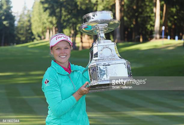 Brooke Henderson of Canada poses with the trophy after winning the KPMG Women's PGA Championship at the Sahalee Country Club on June 12 2016 in...