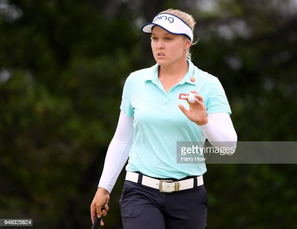 Brooke Henderson of Canada reacts to her par putt on the second green during the fourth round of the LPGA LOTTE Championship at the Ko Olina Golf...