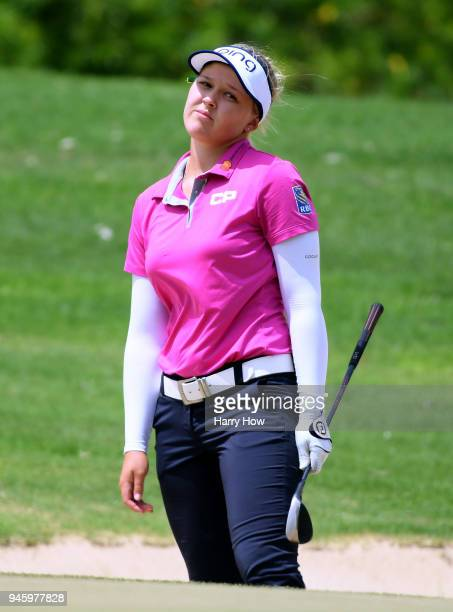 Brooke Henderson of Canada reacts to her shot out of the bunker on the fourth hole during the third round of the LPGA LOTTE Championship at the Ko...