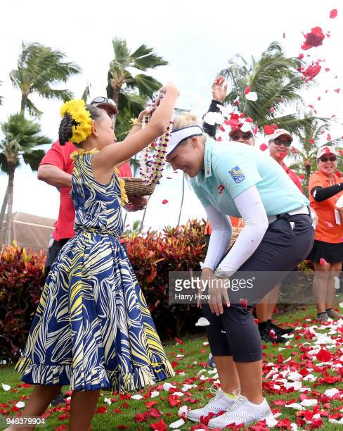 Brooke Henderson of Canada receives a lei at a victory ceremony after her four shot win for the LPGA LOTTE Championship at the Ko Olina Golf Club on...
