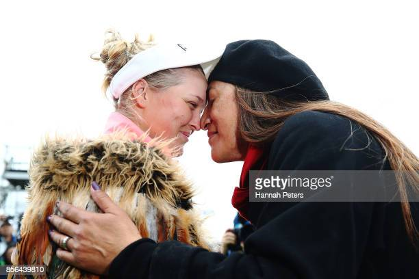 Brooke Henderson of Canada receives a traditional Maori hongi after winning the New Zealand Women's Open trophy by MC Kim during day five of the New...