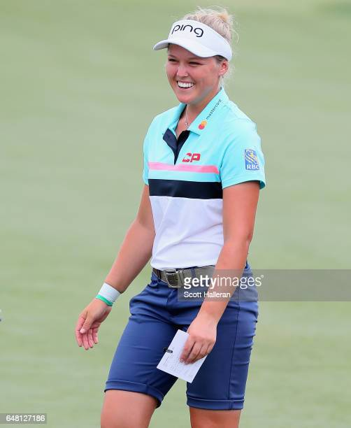 Brooke Henderson of Canada smiles on the 18th green during the final round of the HSBC Women's Champions on the Tanjong Course at Sentosa Golf Club...