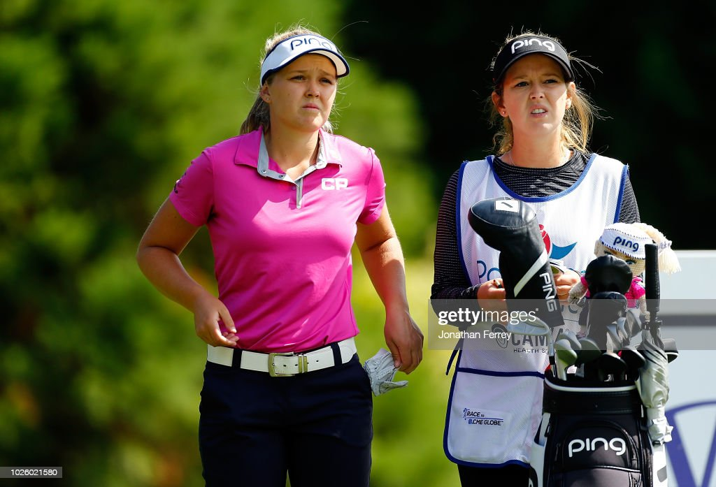 Brooke Henderson of Canada talks to her caddie on the 2nd hole during the third round of the LPGA Cambia Portland Classic at Columbia Edgewater Country Club on September 1, 2018 in Portland, Oregon.