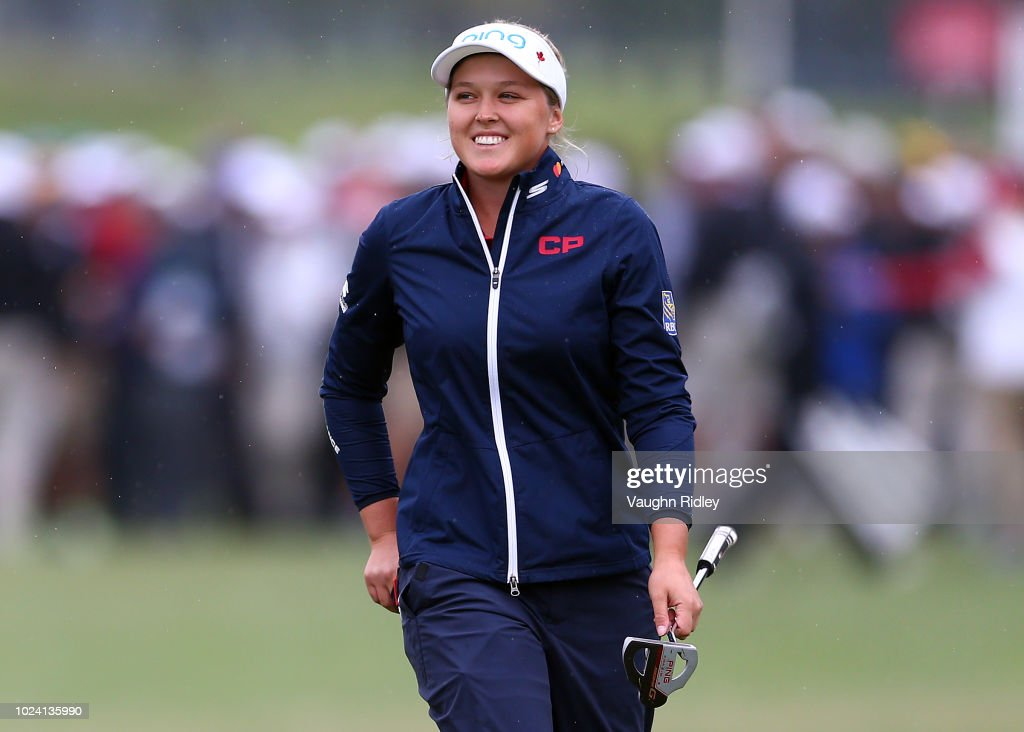 Brooke Henderson of Canada walks up the 18th fairway to applause from the crowd during the final round of the CP Womens Open at the Wascana Country Club on August 26, 2018 in Regina, Canada.