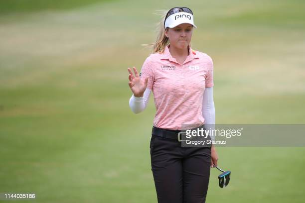 Brooke Henderson of Canada waves to fans after her eagle putt on the fifth green during the final round of the LOTTE Championship at Ko Olina Golf...