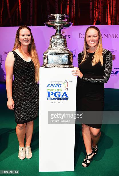 Brooke Henderson of Canada with her sister Brittany Henderson and the Womens PGA trophy at the Rolex Annika Major Awards after the third round of The...