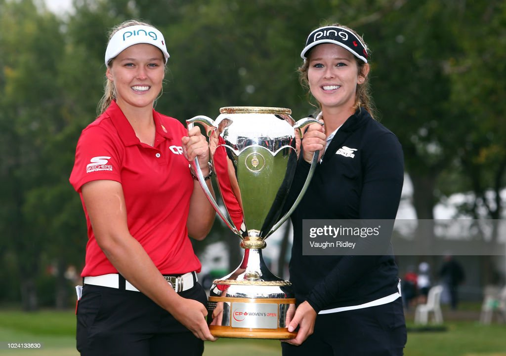 Brooke Henderson of Canada with the champions trophy and her sister & caddie, Brittany, following the final round of the CP Womens Open at the Wascana Country Club on August 26, 2018 in Regina, Canada.