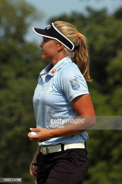 Brooke Henderson of Smith Falls Ontario walks off the 18th green after finishing her putt during the final round of the Marathon LPGA Classic golf...