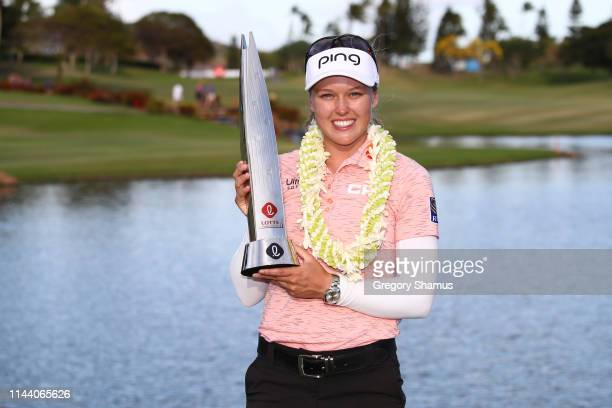 Brooke Henderson poses with the trophy after winning the LOTTE Championship at Ko Olina Golf Club on April 21 2019 in Kapolei Hawaii