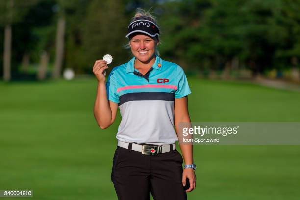 Brooke Henderson shows of the medal for lowest Canadian score after the final round of the Canadian Pacific Women's Open on August 27 2017 at The...