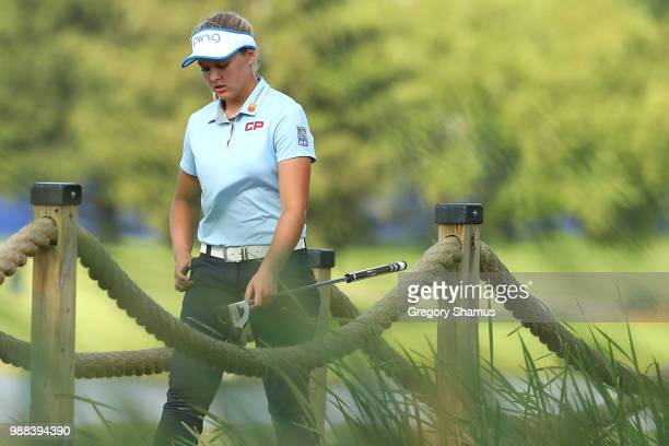 Brooke Henderson walks from the 17th green to the 18th tee during the final round of the 2018 KPMG PGA Championship at Kemper Lakes Golf Club on June...