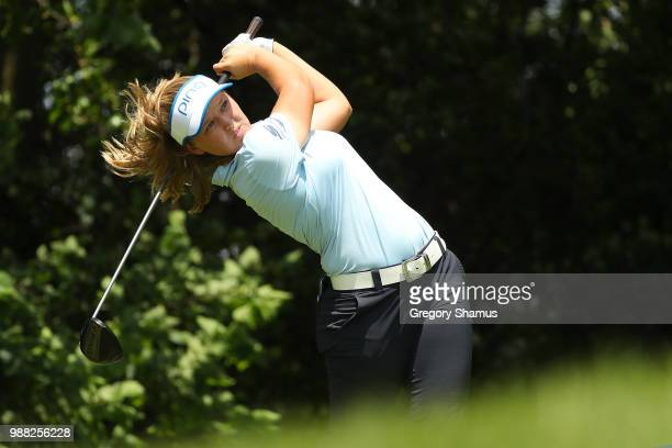 Brooke Henderson watches her drive on the fourth hole during the final round of the 2018 KPMG PGA Championship at Kemper Lakes Golf Club on June 30...