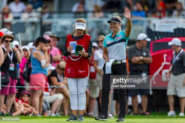 Brooke Henderson waves to the cheering crowd at the 15th hole during the final round of the Canadian Pacific Women's Open on August 27 2017 at The...