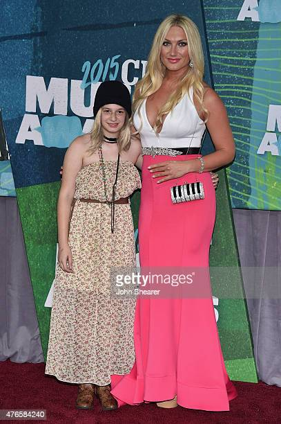 Brooke Hogan and guest Allyson Chernenko attend the 2015 CMT Music awards at the Bridgestone Arena on June 10 2015 in Nashville Tennessee