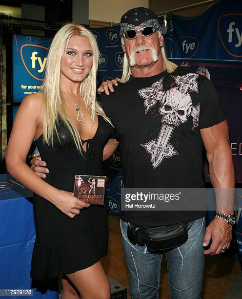 Brooke Hogan and Hulk Hogan during Brooke Hogan Signs her New Album Undiscovered at FYE at FYE in New York City New York United States