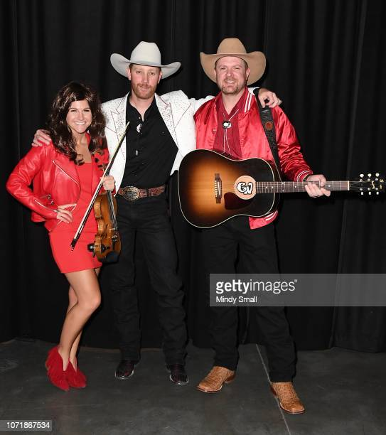 Brooke Latka Chancey Williams and Wyatt Springsteen of Chancey Williams and the Younger Brothers Band pose backstage during the Outside the Barrel...