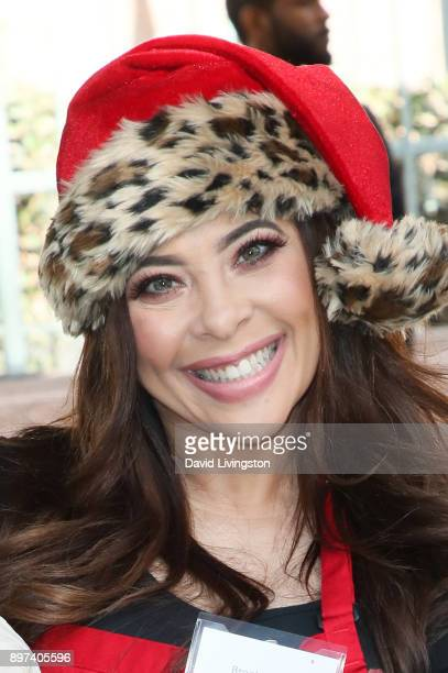 Brooke Lewis is seen at the Los Angeles Mission's Christmas Celebration on Skid Row on December 22 2017 in Los Angeles California