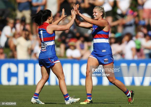 Brooke Lochland and Katie Brennan of the Bulldogs celebrate a goal during the round one AFLW match between the Western Bulldogs and the Fremantle...