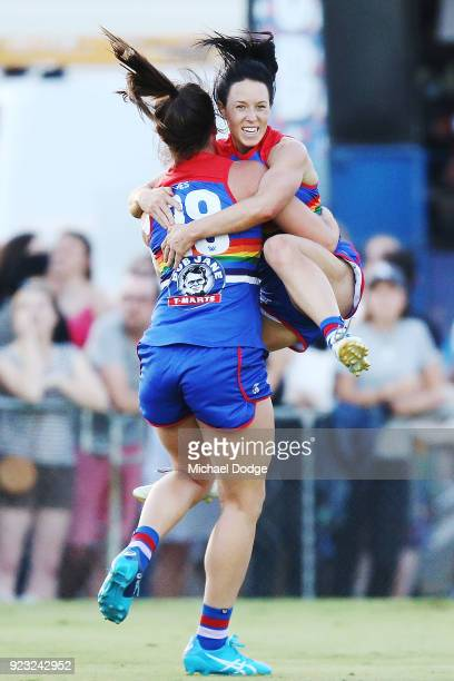 Brooke Lochland of the Bulldogs celebrates a goal as she is hoisted up by Boonie Toogood during the round four AFLW match between the Western...